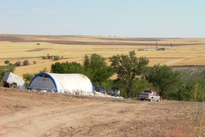 AldridgeMinerals_YPZ097_2 rigs_Southernmost_on_line_YPZ-IP2_View_SSE_over_logging_tent